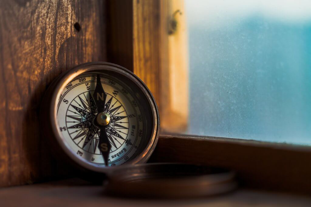 compass leaning against window